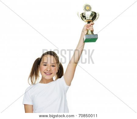 Young female champion raising trophy looking very happy on white background