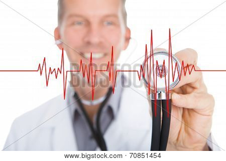 Portrait Of Male Doctor Examining