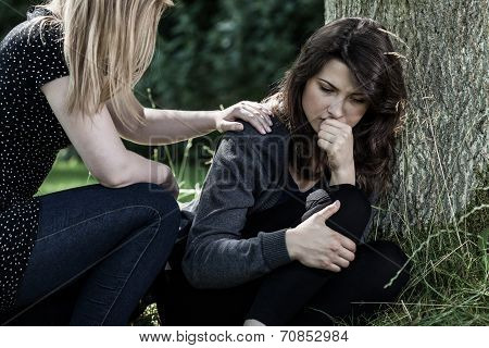 Woman Comforting Her Mourning Friend