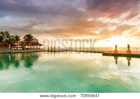 KOH KHO KHAO, THAILAND - 7 NOV 2012: Sunset at swimming pool of Andaman Princess Resort & SPA. Hotel was destroyed by tsunami in 2004 and rebuild, Koh Kho Khao, Phang Nga in Thailand.