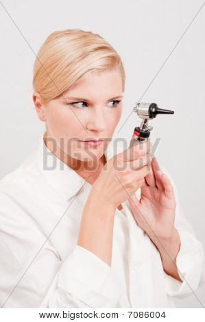 young female doctor with medical tool