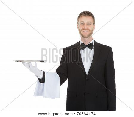 Smiling Young Waiter Holding Empty Serving Tray