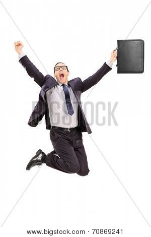 Delighted businessman jumping out of joy isolated on white background