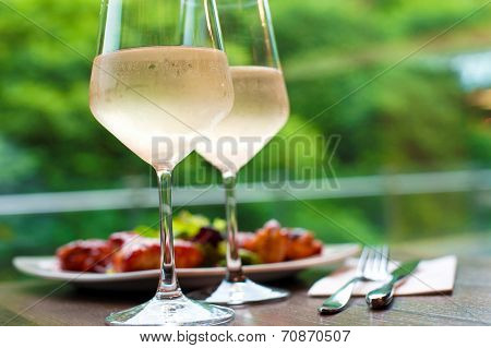 Two Glasses Of Delicious Cooled White Wine With Snack In Restaurant..