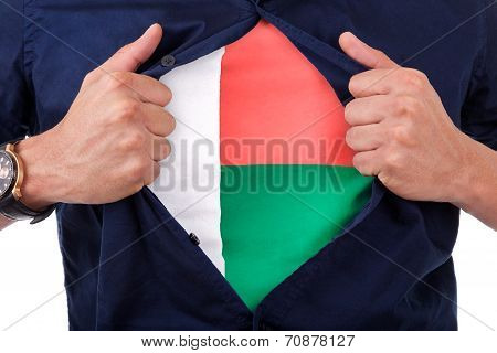 Young Sport Fan Opening His Shirt And Showing The Flag His Country Madagascar, Malagasy Flag