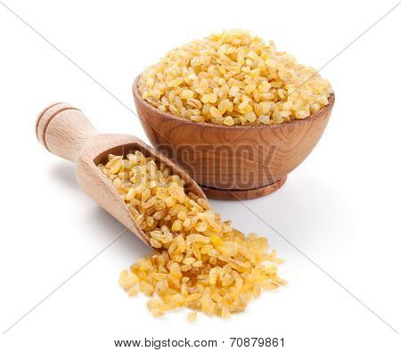 Bulgur In A Wooden Bowl Isolated On White