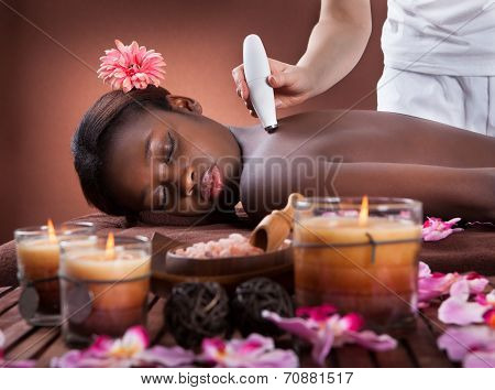 Woman Undergoing Microdermabrasion Therapy At Spa
