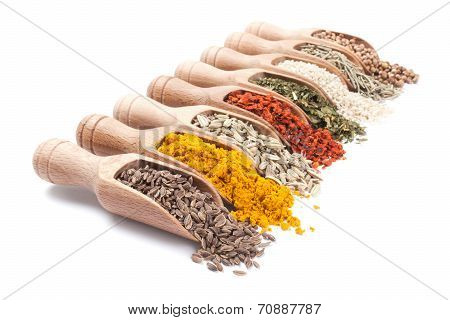 Row Of Wooden Shovels With Spices In Them