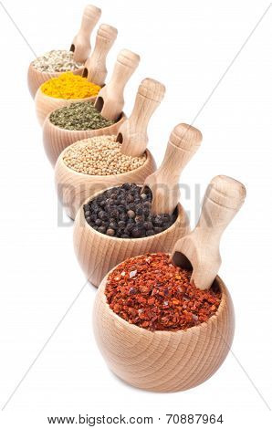 Row Of Wooden Bowls With Spices In Them