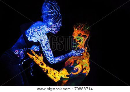 Body art glowing in ultraviolet light,  four elements, Air against Fire