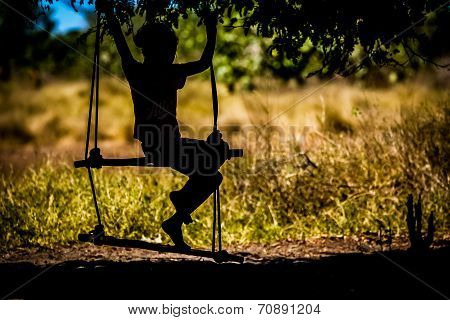 Malagasy girl on a swing