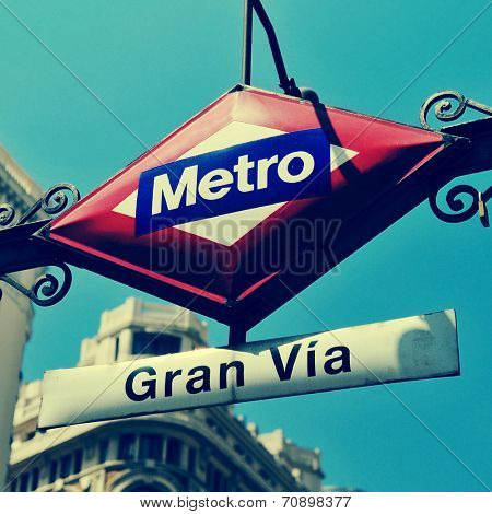 detail of the sign of Gran Via metro station in Madrid, Spain, with a retro effect