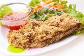 stock photo of catfish  - crispy catfish spicy salad with mango and sweet sauce Thaifood.