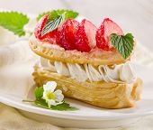 foto of cream puff  - Sweet cream puff with strawberries - JPG