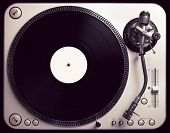 picture of outdated  - Old good looking turntable playing a track from black vinyl - JPG