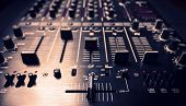 image of controller  - Wide angle photo of black sound mixer controller with knobs and sliders - JPG