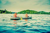 image of canoe boat man  - Two young men in a canoe in wild waters - JPG