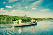 stock photo of canoe boat man  - Two Handsome Guys In A Canoe Down The River - JPG