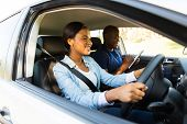 stock photo of seatbelt  - beautiful african woman taking driving test - JPG