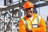 image of substation  - african electrical worker in electric substation - JPG