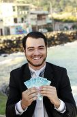 pic of brazilian money  - business man with money brazilian on the hands - JPG