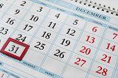 stock photo of thursday  - 31 december on calendar as a background - JPG