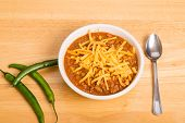 stock photo of poblano  - A bowl of chili con carne with beans and green chili peppers - JPG