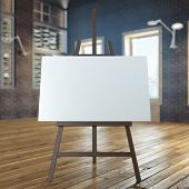 picture of canvas  - easel with empty canvas in interior - JPG