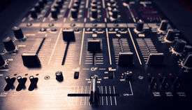 stock photo of controller  - Wide angle photo of black sound mixer controller with knobs and sliders - JPG