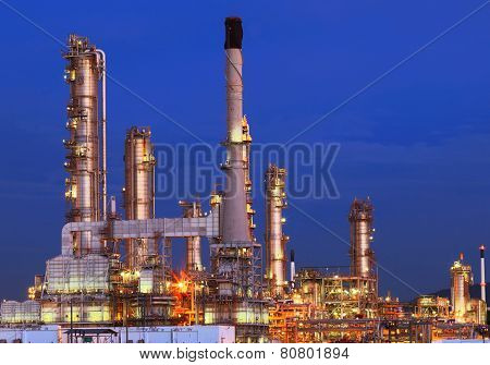 Beautiful Lighting Of Oil Refinery Plant In Petrochemical Heavy Industry Estate Against Clear Blue S