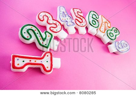 Birthday Candles Against Colourful Background