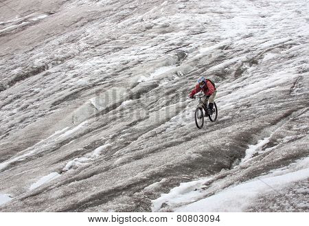 MTB biker  going downhill the glacier from mt. Elbrus.