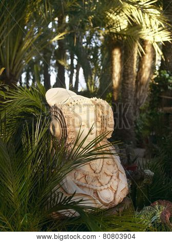 Dama De Elche Figure In Palm Tree Garden. Alicante. Spain