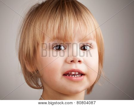 Close-up Portrait Of Cute Blond Caucasian Baby Girl