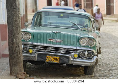 Vintage American car parked at the street Trinidad, Cuba.