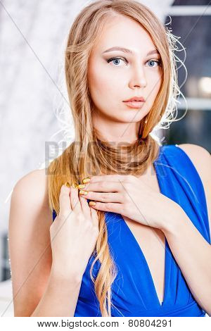 Attractive Blond Girl With Long Hair And Golden Manicure