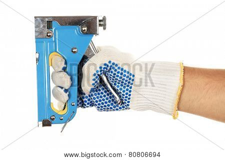 Staple gun in male hand isolated on white