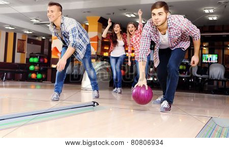 Friends playing in bowling club