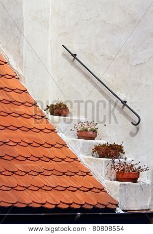 Fragment Of A Red Roof On White Wall Background