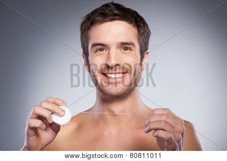 Man With Dental Floss.