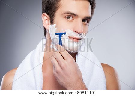 Handsome Man Shaving.