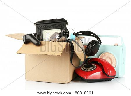 Box of unwanted stuff isolated on white