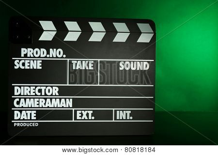 Movie clapper on dark color background