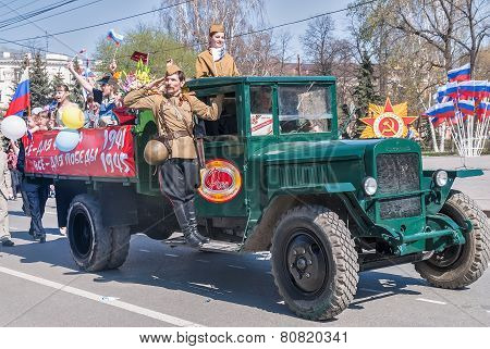 ZIS-5 truck with soldier and girls on parade