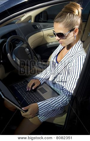 Businesswoman Uses Laptop