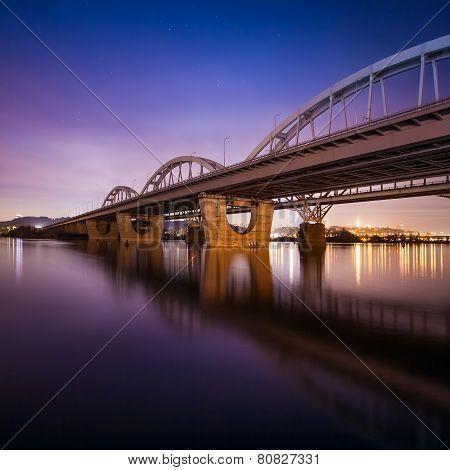Railway bridge in Kiev at night. Ukraine.