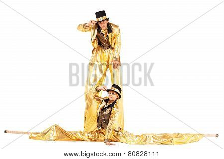 Boy And Girl On Stilts