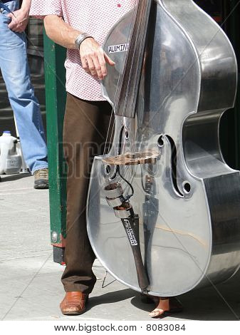 Bass Fiddle Player In Street Band