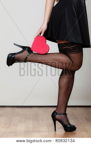 Sexy Young Woman Holding Gift