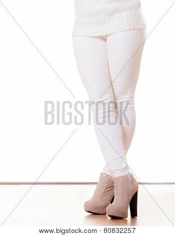Winter Fashion. Female Legs In Stylish Shoes Isolated